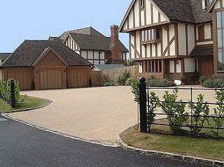 Driveway: Resin bonded surface Road: tarmac AC10